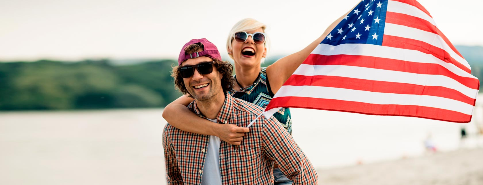 couple at lake with American flag
