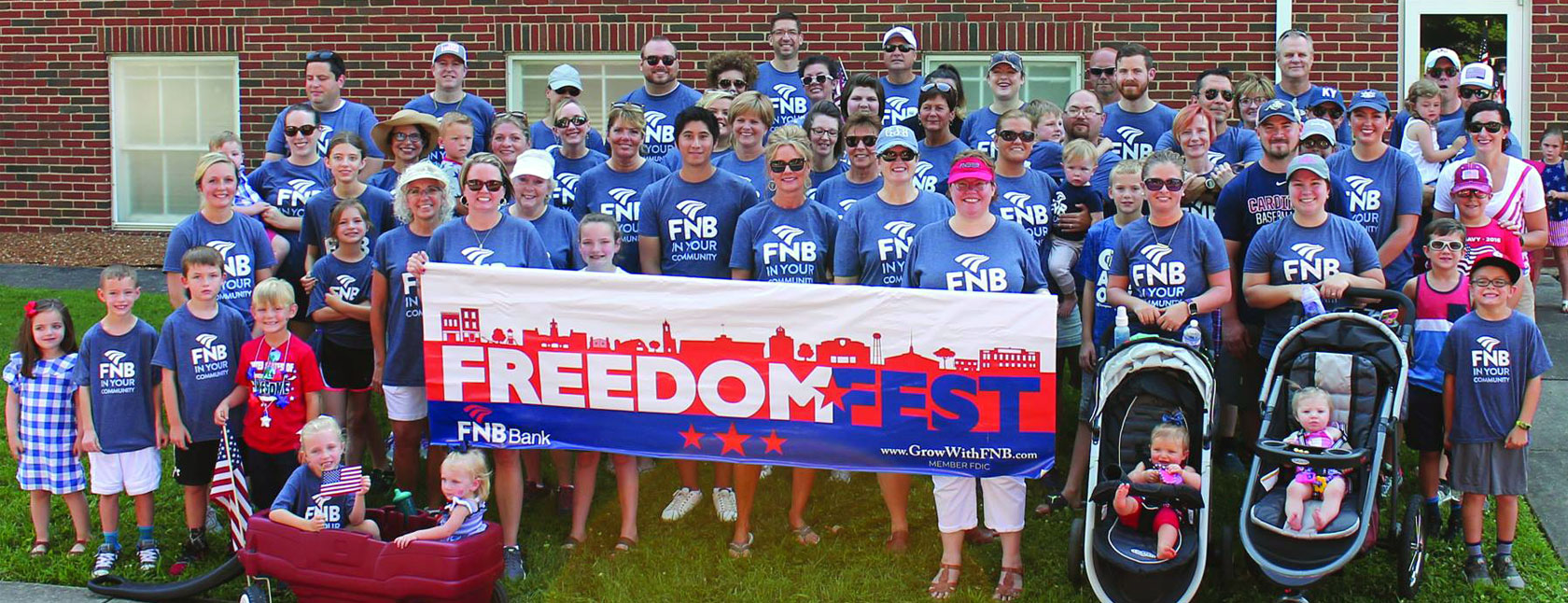 Freedom Fest FNB Bank Kentucky sign held up by many people